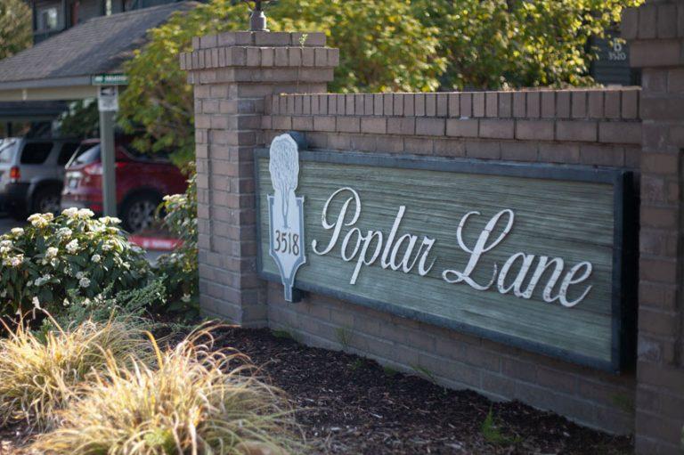 Poplar Lane sign. It is made of bricks.
